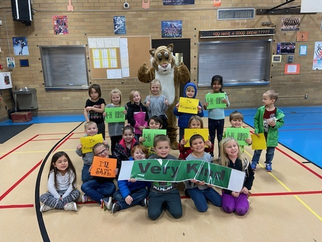 Students holding signs about our Bobcat Beliefs