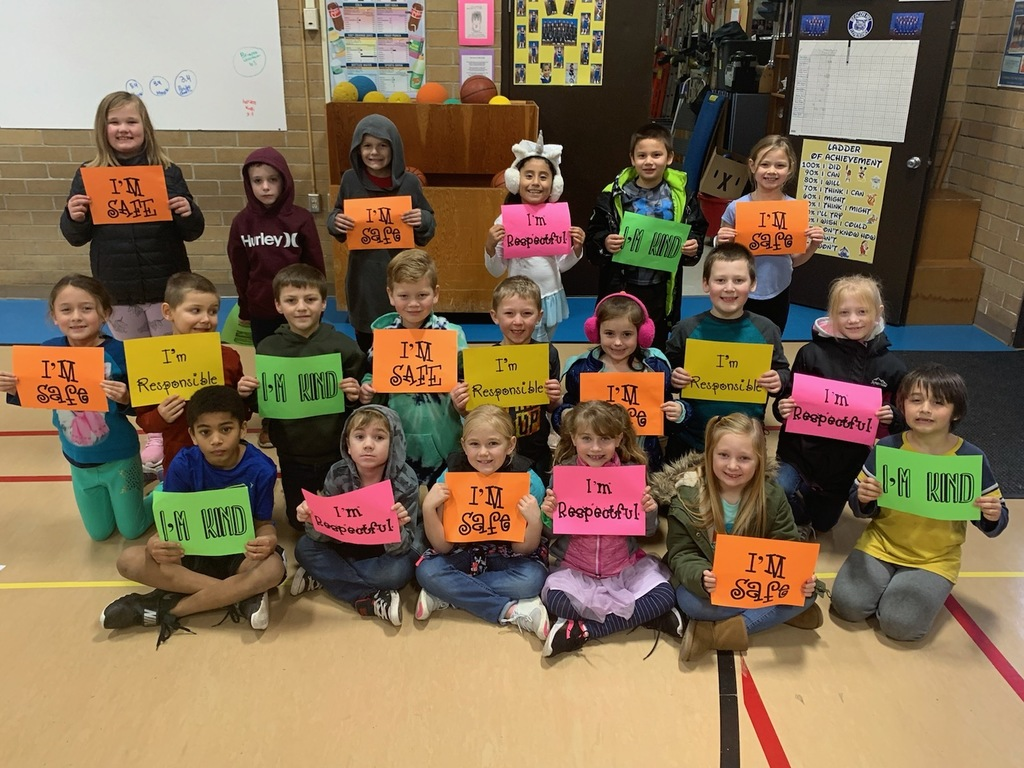 students holding sign of our Bobcat Beliefs