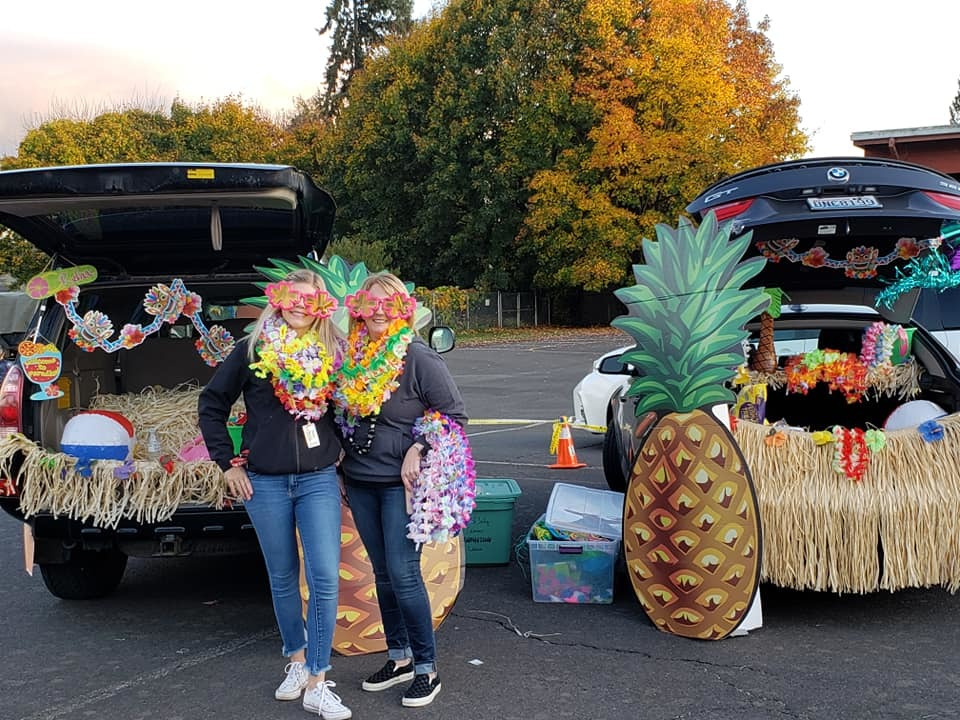teachers in the parking lot with decorated car